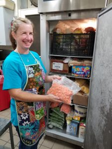 CFR MEMBERS BUILD THEIR CAPACITY TO SERVE woman at freezer