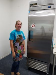 UNSUNG HEROES FOOD ASSISTANCE PROVIDERS PART 2 woman in front of freezer